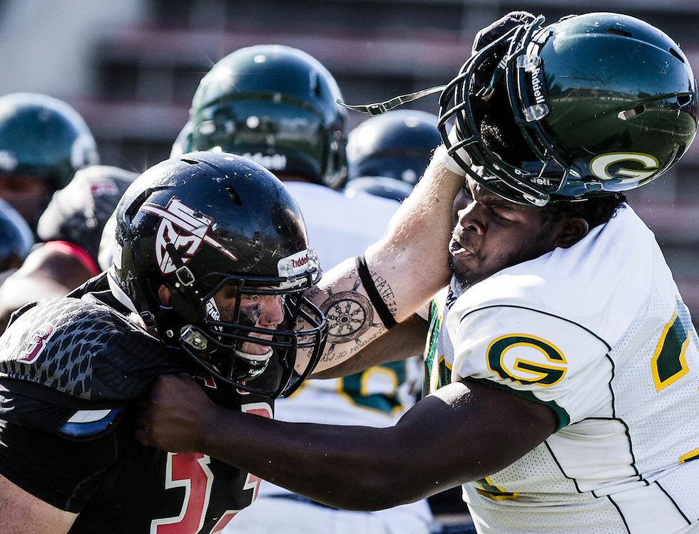 Justin Lantz (33) of Santa Ana College battles Devonte Rodgers (36) of Grossmont College. Grossmont defeated Santa Ana College 30-23 at Santa Ana Stadium.
