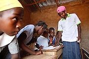 Abdulai Sadia teaches children in the community of Kunayili, near Gushegu, Northern Ghana, on Wednesday November 2, 2011.