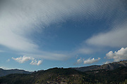 Landscape view of altostratus undulatus cloud formations on 14th September 2017 in Marignana, Corsica, France. Corsica is an island in the Mediterranean and one of the 18 regions of France. It is located southeast of the French mainland and west of the Italian Peninsula.