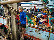 01 OCTOBER 2015 - MAHACHAI, SAMUT SAKHON, THAILAND: A crewman gets off a fishing trawler in Mahachai, one of Thailand's largest fishing ports. Thailand's fishing industry had been facing an October deadline from the European Union to address issues related to overfishing and labor practices. Failure to adequately address the issues could have resulted in a ban on Thai exports to the EU. In September Thai officials announced that they had secured an extension of the deadline. Officials did not say how much extra time they had to meet the EU goals. Thailand's overall annual exports to the EU are between 23.2 billion Thai Baht and 30 billion Thai Baht (US$645 million to US $841 million). Thailand's total fish exports were worth about 110 billion baht in 2014.    PHOTO BY JACK KURTZ