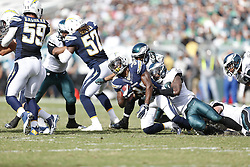 San Diego Chargers running back Fozzy Whittaker #34 is tackled to the ground during the NFL game between the San Diego Chargers and the Philadelphia Eagles in Philadelphia. The Chargers won 33-30. (Photo by Brian Garfinkel)