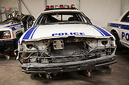Destroyed Police car that is part of a collection of artifacts saved from the site of the World Trade Center after 9/11. Artifacts chosen by curators out of the wreckage  from the World Trade Center  stored temporarily within an 80,000 square foot hanger at JFK airport. Some of the artifacts will be in the National September 11 memorial Museum set to open in 2012.