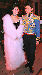 MR & MRS ANDY WONG the London based Hong Kong millionaires, at a party in London on 31st January 1998.MEZ 10