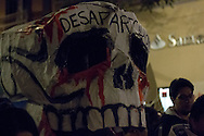 """People march with a big skull with the legend of """"Dissappeared"""" protesting the disappearance of 43 students in Iguala, Guerrero."""