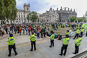 Police officers form a line outside Parliament as members of the Extinction Rebellion (XR) environmental campaign group gather in central London to blockade Parliament. XR plan to peacefully disrupt the UK Parliament with actions planned over two weeks, until MPs back the Climate and Ecological Emergency Bill and prepare for crisis with a National Citizens' Assembly. (VXP Photo/ Vudi Xhymshiti)
