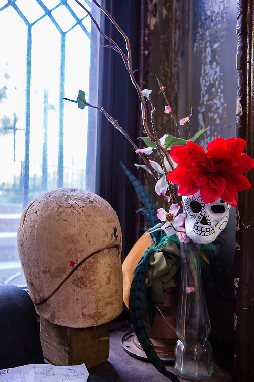 A balsa head used for trimming hats sits in a window.