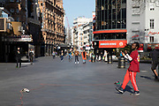 Breakdancer street performer dances to an almost non-existent audience in a Leicester Square almost deserted due to the Covid-19 outbreak social distancing on what would normally be a busy, bustling day with hoards of people out to shop and socialise on 22nd March 2020 in London, England, United Kingdom. Coronavirus or Covid-19 is a new respiratory illness that has not previously been seen in humans. While much or Europe has been placed into lockdown, the UK government has announced more stringent rules as part of their long term strategy, and in particular social distancing.