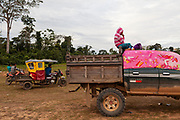 Daily life, some people watch a soccer game in Boca Colorado, Peru. Boca Colorado is a town formed entirely by mining activity in the Peruvian Amazon.