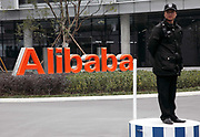 A guard stands at the gate of an Alibaba operations center in Hangzhou, China on 27 January 2010. Alibaba is the premier business to business portal in China.