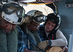 170909-N-NM806-219 <br /> ST. THOMAS, U.S. Virgin Islands (Sept. 9, 2017) Naval Aircrewman (Helicopter) 2nd Nicholas Glass, assigned to Helicopter Sea Combat Squadron (HSC) 22, assigned to the amphibious assault ship USS Wasp (LHD 1), prepares a resident for evacuation as part of first response efforts to the U.S. Virgin Islands in the wake of Hurricane Irma. The Department of Defense is supporting the Federal Emergency Management Agency, the lead federal agency, in helping those affected by Hurricane Irma to minimize suffering and is one component of the overall whole-of-government response effort. (U.S. Navy photo by Mass Communication Specialist Seaman Taylor King/Released)