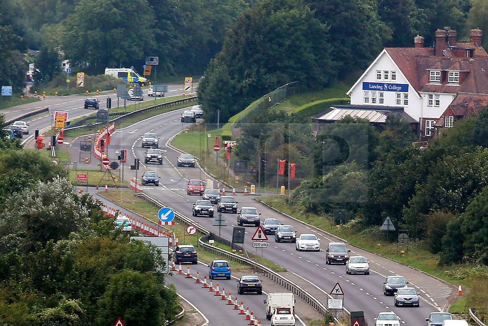 © Licensed to London News Pictures. 29/08/2015. Shoreham, UK. The A27 re-opened partly today after being closed for a week when a Hunter Hawker fight jet crashed during the Shoreham Airshow on August 22nd killing 11 people. Today August 29th 2015. Photo credit : Hugo Michiels/LNP