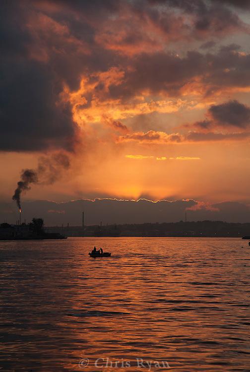 Fisherman leaving harbor at sunrise, Havana, Cuba