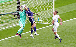 Scotland's Lyndon Dykes challenges Czech Republic goalkeeper Tomas Vaclik for the ball during the UEFA Euro 2020 Group D match at Hampden Park, Glasgow. Picture date: Monday June 14, 2021.