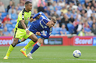 Reading's Liam Moore (l) holds back Cardiff City's Anthony Pilkington. EFL Skybet championship match, Cardiff city v Reading at the Cardiff city stadium in Cardiff, South Wales on Saturday 27th August 2016.<br /> pic by Carl Robertson, Andrew Orchard sports photography.