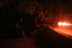 The Marines of Bravo Company 1st BN 4th Marines carry our a raid on a technical college in Kufa believed to be held by fighters from the Moqtada al-Sadr-led Mehdi Army during the Battle of Najaf on August 19, 2004.<br />