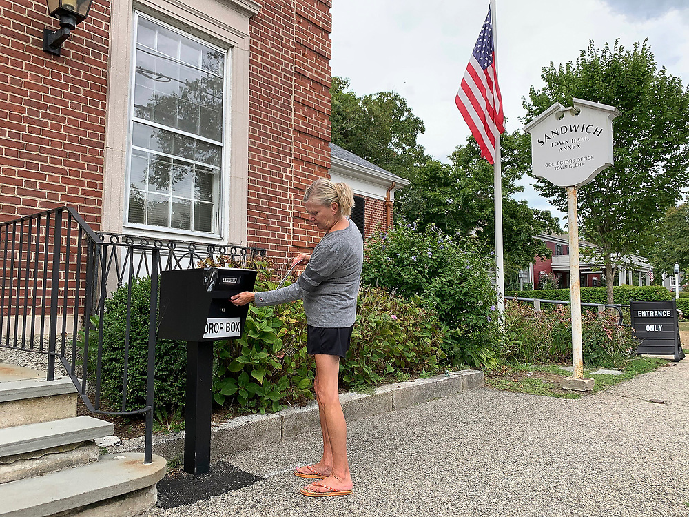 Voters in Sandwich, Massachusetts and across the country are using secure drop boxes to deposit their absentee ballots, also referred to as mail-in ballots, to make sure they arrive in time to be counted. The U.S. Postal Service has warned that voters could see their mail-in ballots go uncounted due to mail delivery delays.