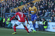 CJ Hamilton of Mansfield Town (22) is stopped by Mark Marshall of Charlton Athletic (7) during the The FA Cup match between Mansfield Town and Charlton Athletic at the One Call Stadium, Mansfield, England on 11 November 2018.