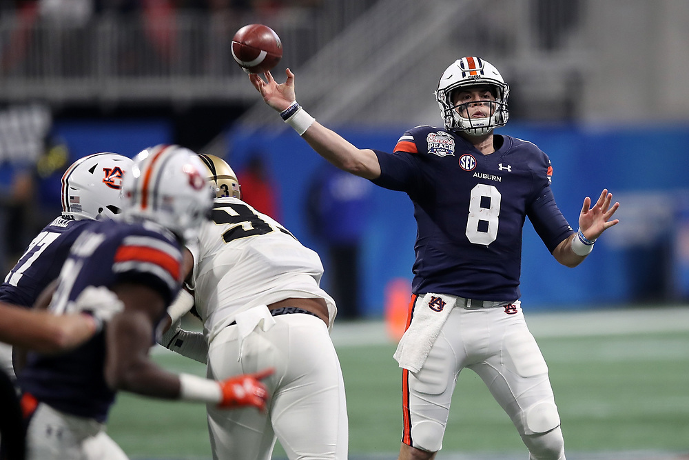 Auburn Tigers quarterback Jarrett Stidham (8) throws a pass during the 2018 Chick-fil-A Peach Bowl NCAA football game against the UCF Knights on Monday, January 1, 2018 in Atlanta. (Jason Parkhurst / Abell Images for the Chick-fil-A Peach Bowl)