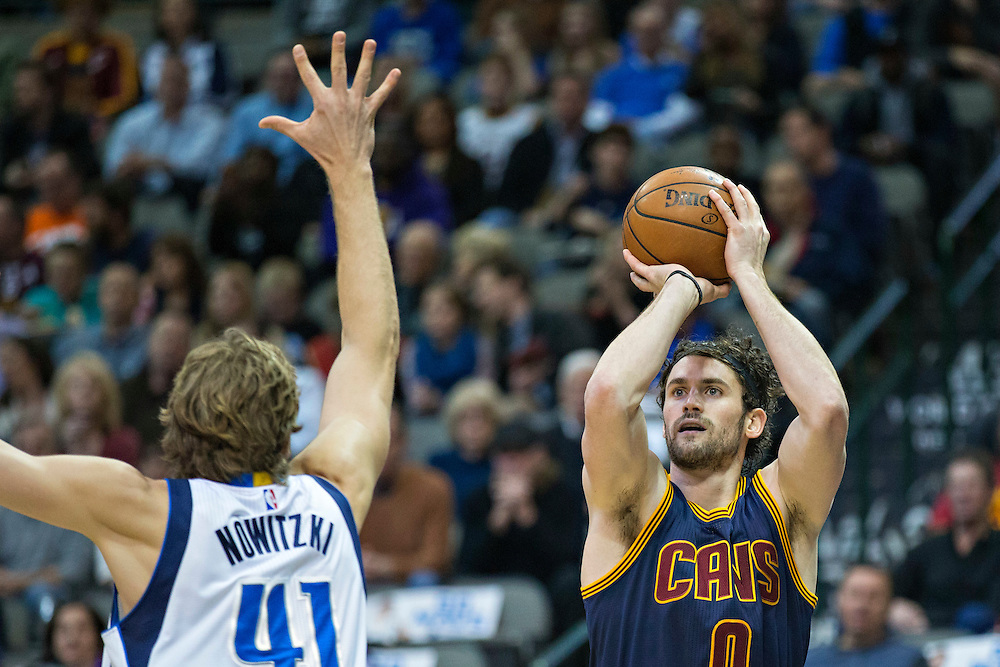 DALLAS, TX - JANUARY 12:  Kevin Love #0 of the Cleveland Cavaliers shot a jump shot over Dirk Nowitzki #41 of the Dallas Mavericks at American Airlines Center on January 12, 2016 in Dallas, Texas.  NOTE TO USER: User expressly acknowledges and agrees that, by downloading and or using this photograph, User is consenting to the terms and conditions of the Getty Images License Agreement.  The Cavaliers defeated the Mavericks 110-107.  (Photo by Wesley Hitt/Getty Images) *** Local Caption *** Kevin Love; Dirk Nowitzki