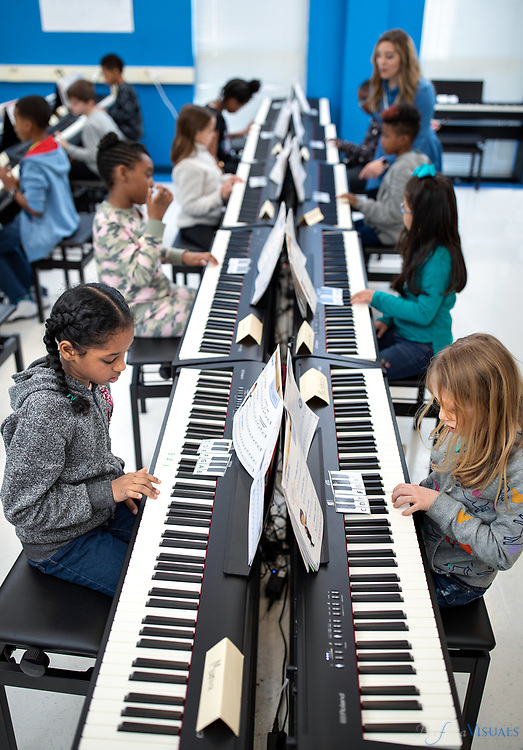 Music teacher Winnona Roshan works with her students at Jefferson elementary school.<br /> <br /> Five Guilford County elementary schools acquired 20 to 30 electric pianos, allowing them to create a piano lab at each school and give students a stronger music education experience. Lang Lang International Music Foundation, which is supplying the pianos for Irving Park, Falkener, Sedgefield and Jefferson elementary schools in Greensboro and Oak View Elementary in High Point. The foundation also provided training for the music teachers at those schools and access to a music library.<br /> <br /> Photographed, Thursday, January 31, 2019, in Greensboro, N.C. JERRY WOLFORD and SCOTT MUTHERSBAUGH / Perfecta Visuals