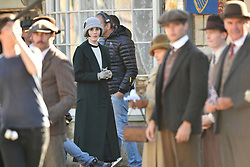 Michelle Dockery and other cast members on the Downton Abbey film set in Lacock, Wiltshire.