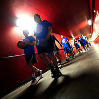 031513  Adron Gardner/Independent<br /> <br /> The Navajo Pine Lady Warriors walk down the tunnel at The Pit to face off with the Laguna Acoma Lady Hawks for the 2A New Mexico High School Basketball State Championship in Albuquerque Friday.