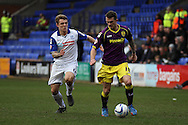 Notts County's Jimmy Spencer (r) holds off  Tranmere Rovers' Max Power. Skybet football league one match, Tranmere Rovers v Notts county at Prenton Park in Birkenhead, England on Saturday 15th March 2014.<br /> pic by Chris Stading, Andrew Orchard sports photography.