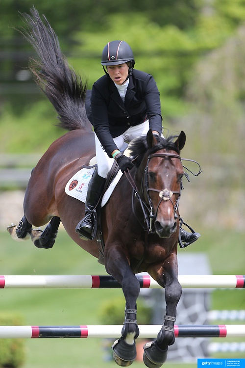 Beezie Madden riding Breitling LS in action during the $35,000 Grand Prix of North Salem presented by Karina Brez Jewelry during the Old Salem Farm Spring Horse Show, North Salem, New York, USA. 15th May 2015. Photo Tim Clayton