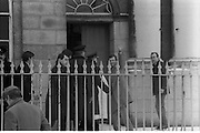 Peter Robinson At Special Criminal Court.  (R48)..1987..13.01.1987..01.13.1987..13th January 1987..Following a masked incursion into Clontibret, Co Monaghan,Ulster politician Peter Robinson and two others were charged by the police. The incursion was to highlight Unionist opposition to the Anglo Irish Agreement. As a result Mr Robinson faced the Special Criminal Court In Dublin. Mr Robinson was convicted for unlawful assembly and fined £17,500. Charges relating to assault on Gardai and malicious damages were dropped. Afterwards Mr Robinson said that he was thankful to the court for not imposing a custodial sentence...Image shows  Peter Robinson waving to reporters as he enters the Special Criminal Court, Green Street,Dublin.