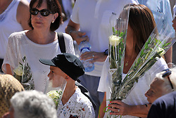 People dressed in white gather around the make shift memorial as they attend a minute of silence held for the victims of the Bastille Day attack in the city of Nice, southeastern France, on August 07, 2016. Eighty-five people were killed and many were wounded after a jihadist ploughed a 19-tonne truck into a massive crowd celebrating Bastille Day, killing 85 people and wounding more than 400 others along the famous Promenade des Anglais during the July 14 celebrations. Photo by Pierre Rousseau/Cit'images/ABACAPRESS.COM