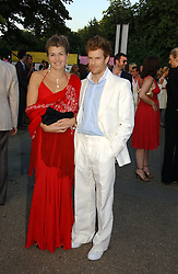 AMBER NUTTALL and TOM AIKENS at the Serpentine Gallery Summer party sponsored by Yves Saint Laurent held at the Serpentine Gallery, Kensington Gardens, London W2 on 11th July 2006.<br /><br />NON EXCLUSIVE - WORLD RIGHTS