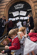 Children and campaigners protesting the closure by Lambeth council of Carnegie Library on day 3 of its occupation in Herne Hill, south London on 3rd April 2016. The angry local community in the south London borough have occupied their important resource for learning and social hub for the weekend. After a long campaign by locals, Lambeth have gone ahead and closed the library's doors for the last time because they say, cuts to their budget mean millions must be saved. A gym will replace the working library and while some of the 20,000 books on shelves will remain, no librarians will be present to administer it.