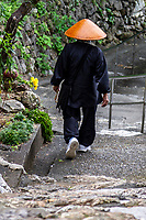 Henro is the Japanese word for pilgrim - they are recognizable by their white clothing, sedge hats and special walking sticks with bells. The most famous trail in Japan is around Shikoku Island's 88 temples.  Nowadays it is common to undertake pilgrimages in stages, completing one cycle in a number of trips; many devotees repeat the pilgrimage - even hundreds of times. Some become so addicted to the sites and the route that they spend their entire lives on the road and end their pilgrimage only in death, a memorial stone marking the ending  of their life's journey.