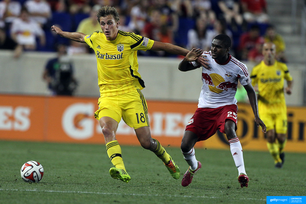 Aaron Schoenfeld, (left), Columbus Crew, is challenged by   Chris Duvall, New York Red Bulls, during the New York Red Bulls Vs Columbus Crew, Major League Soccer regular season match at Red Bull Arena, Harrison, New Jersey. USA. 12th July 2014. Photo Tim Clayton
