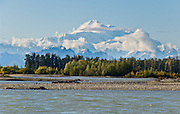 See Mount McKinley from the confluence of the Talkeetna and Susitna Rivers at Talkeetna, Alaska, USA. Denali (20,310 feet or 6191 meters, aka Mount McKinley) is the highest mountain peak in North America. Measured from base to peak, it is earth's tallest mountain on land. Mount McKinley is a granitic pluton uplifted by tectonic pressure while erosion has simultaneously stripped away the somewhat softer sedimentary rock above and around it.
