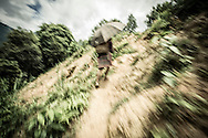 Blurred shot of a Red Dao girl hiking up the steep terrain holding an umbrella, Thanh Kim Commune, Sapa District, Lao Cai Province, Vietnam, Southeast Asia