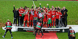 CARDIFF, WALES - Tuesday, October 13, 2015: Wales players and staff celebrate on the pitch after qualifying for the finals following a 2-0 victory over Andorra during the UEFA Euro 2016 qualifying Group B match at the Cardiff City Stadium. (Pic by Paul Currie/Propaganda)