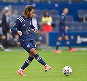 May 16, 2021 - Kansas City, KS, United States:   Sporting Kansas City forward Gianluca Busio (10) moves the ball downfield.  Sporting KC beat the Vancouver Whitecaps FC 3-0 in a Major League Soccer game. <br /> Photo by Tim Vizer/Polaris