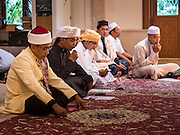 17 JULY 2015 - BANGKOK, THAILAND:     Men pray in Ton Son Mosque before services marking Eid al-Fitr. Eid al-Fitr is also called Feast of Breaking the Fast, the Sugar Feast, Bayram (Bajram), the Sweet Festival or Hari Raya Puasa and the Lesser Eid. It is an important Muslim religious holiday that marks the end of Ramadan, the Islamic holy month of fasting. Muslims are not allowed to fast on Eid. The holiday celebrates the conclusion of the 29 or 30 days of dawn-to-sunset fasting Muslims do during the month of Ramadan. Islam is the second largest religion in Thailand. Government sources say about 5% of Thais are Muslim, many in the Muslim community say the number is closer to 10%.          PHOTO BY JACK KURTZ
