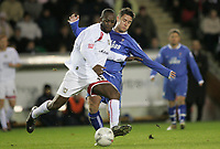Photo: Marc Atkins.<br /> Milton Keynes Dons v Farsley Celtic. The FA Cup. 21/11/2006. James Knowles (R) of Farsley Celtic battles for the ball with Leon Crooks of MK Dons.