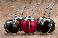 Group of calabash mate cups with straws.,Mate is a traditional drink very similar to tea in Argentina, Uruguay, Paraguay and some parts of Brazil.