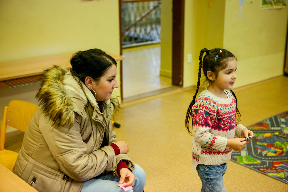Esther Kroscenova (6) with her mother Daniela Kroscenova (27) waiting for an enrollment examination (test) of daughter Esther who should be a first class pupil in the school year 2016/2017 in a mainstream school in the city of Ostrava, where Roma and non Roma children are educated together. The school is named ZS Chrustova elementary school.