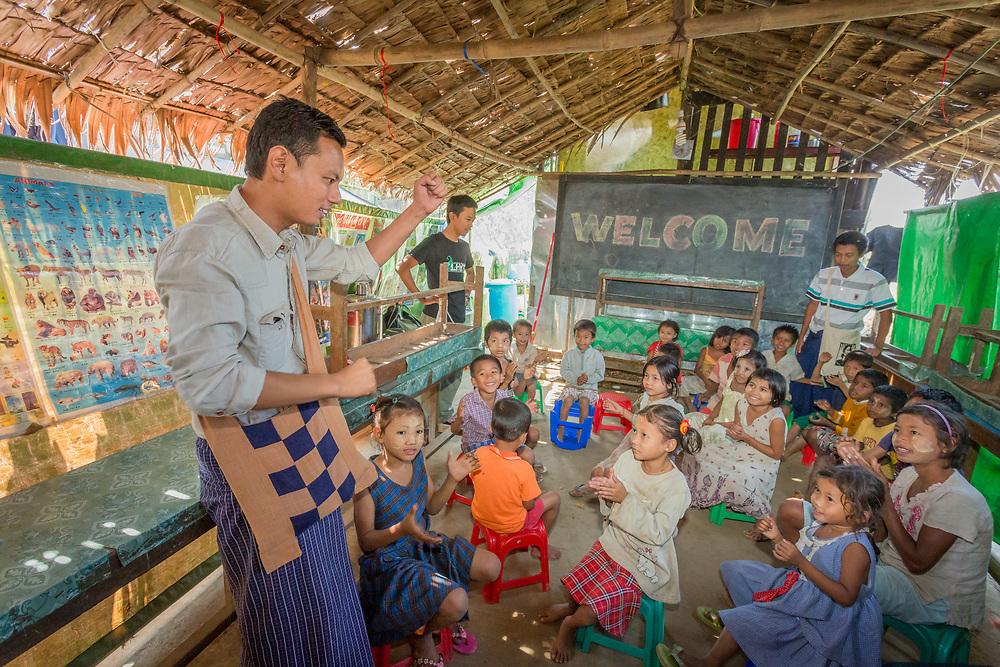 Asia, Myanmar, children in outdoor classroom run by EduNet, Partners in Asia,