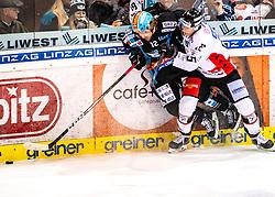 26.12.2019, Keine Sorgen Eisarena, Linz, AUT, EBEL, EHC Liwest Black Wings Linz vs HC Orli Znojmo, 31. Runde, im Bild v.l. Alexander Cijan (EHC Liwest Black Wings Linz), Antonin Boruta (HC Orli Znojmo) // during the Erste Bank Eishockey League 31th round match between EHC Liwest Black Wings Linz and HC Orli Znojmo at the Keine Sorgen Eisarena in Linz, Austria on 2019/12/26. EXPA Pictures © 2019, PhotoCredit: EXPA/ Reinhard Eisenbauer