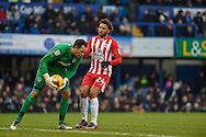Accrington Stanley Forward, Jonathan Edwards (24) closes down Portsmouth Goalkeeper, David Forde (1) during the EFL Sky Bet League 2 match between Portsmouth and Accrington Stanley at Fratton Park, Portsmouth, England on 11 February 2017. Photo by Adam Rivers.