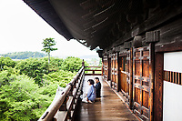 A man and woman at a serene temple in Kyoto, Japan.