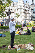 Muslim prayer is seen exercising his religious ritual after a protest organised by the Black Lives Matter movement was dispersed in Parliament Square, Central London on Saturday, July 11, 2020. People are gathered to protest against systematic racial injustice in Britain. People most of them wearing protective face surgical masks in an effort to curb the spread of coronavirus pandemic outbreak, took part in the seventh weekend of anti-racism protests. <br /> Anger against systemic levels of institutional racism have raged through the city, and worldwide; sparked by the death of George Floyd who died on May 25 after he was restrained by Minneapolis police in the United States. (VXP Photo/ Vudi Xhymshiti)