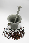 old bronze pestle and mortar used to finely grind or pound the coffee beans, on white background