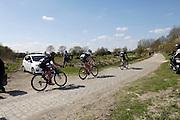 France, Sunday 12th April 2015: The eight man break leads the 2015 edition of Paris Roubaix cycle race through Pont Gibus. The break comprised the following riders, Gregory Rast (Trek Factory Racing), Adam Blythe (Orica-GreenEdge), Alexis Gougeard (Ag2r-La Mondiale), Aleksejs Saramotins (IAM Cycling), Pierre-Luc Perichon (Bretange-Seche), Tim Declercq (Topsport-Vlaanderen), Frederik Backaert (Wanty Groupe Gobert) and Ralf Matzka (Bora Argon 18).