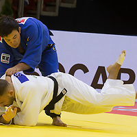 Aaron Wolf (in blue) of Japan and Karl-Richard Frey (in white) of Germany fight during the Men -90 kg category at the Judo Grand Prix Budapest 2018 international judo tournament held in Budapest, Hungary on Aug. 12, 2018. ATTILA VOLGYI